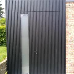 Abri de jardin sur mesure en menuiserie et bardage aluminium réalisé par Menuisal