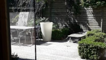 Extension avec des menuiseries aluminium  à angle vitré réalisé par MENUISAL